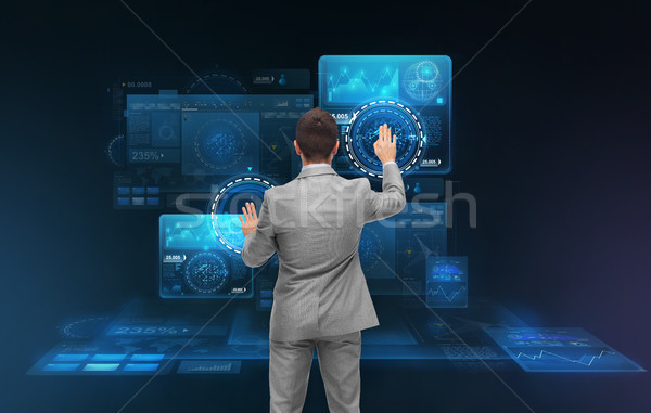 businessman working with virtual screens Stock photo © dolgachov