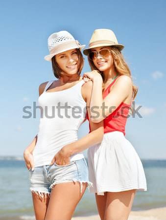 笑みを浮かべて 若い女性 ビーチ 夏 休日 ストックフォト © dolgachov