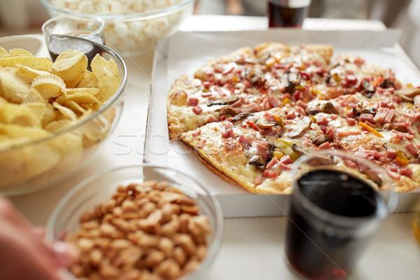 Pizza egyéb gyorsételek harapnivalók asztal egészségtelen étkezés Stock fotó © dolgachov