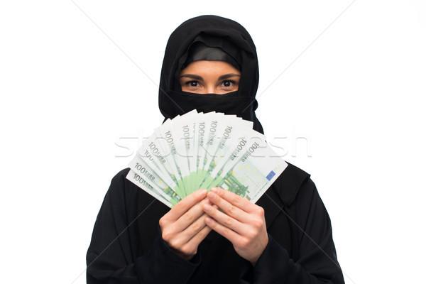 Muslim donna hijab soldi bianco Foto d'archivio © dolgachov