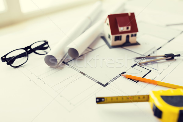 Stock photo: close up of architectural blueprint and tools