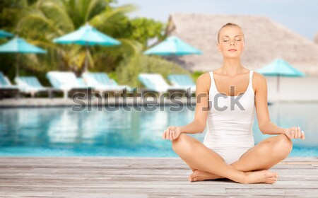 beautiful woman in towel with bare top on beach Stock photo © dolgachov