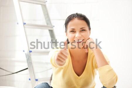 smiling florist woman or gardener at flower shop Stock photo © dolgachov