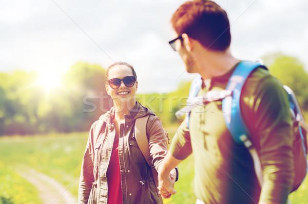 happy couple with backpacks hiking outdoors Stock photo © dolgachov