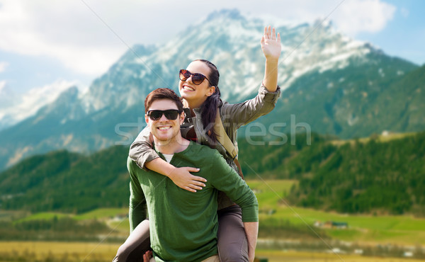 happy couple with backpacks having fun outdoors Stock photo © dolgachov