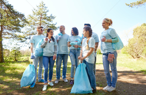 volunteers with garbage bags walking outdoors Stock photo © dolgachov