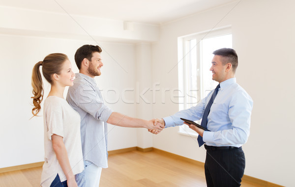 man and realtor shaking hands at new home Stock photo © dolgachov