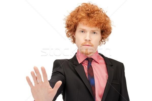 man making stop gesture Stock photo © dolgachov