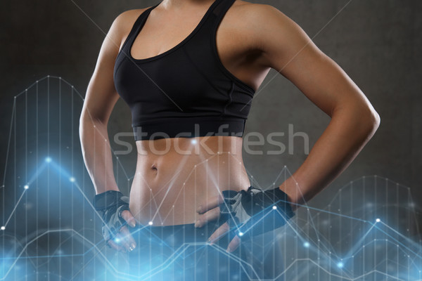 young woman body in gym Stock photo © dolgachov
