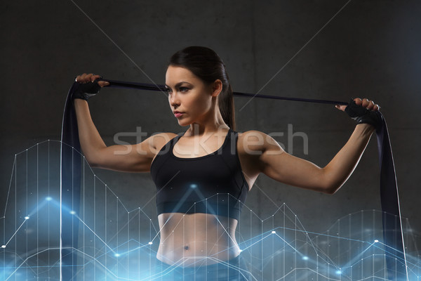 woman with expander exercising in gym Stock photo © dolgachov