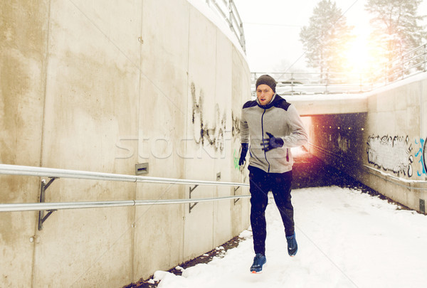 man running out of subway tunnel in winter Stock photo © dolgachov
