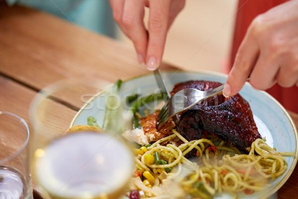 Mãos mulher garfo alimentação frango assado comida Foto stock © dolgachov