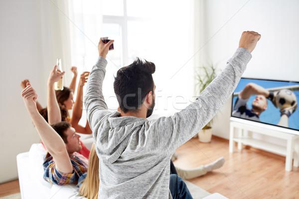 Amici guardare calcio calcio gioco tv Foto d'archivio © dolgachov