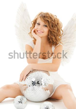 sexy santa helper with disco ball Stock photo © dolgachov