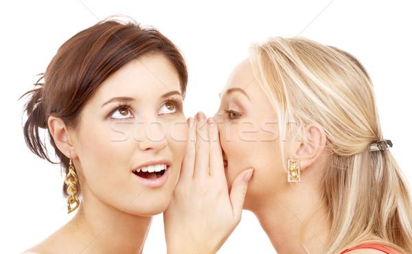 Pettegolezzi due felice giovani parlando Foto d'archivio © dolgachov