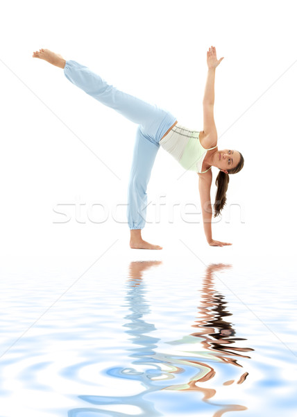 ardha chandrasana half moon pose on white sand Stock photo © dolgachov