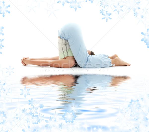 halasana plow pose on white sand Stock photo © dolgachov