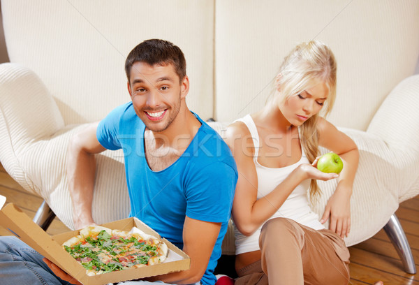 couple eating different food Stock photo © dolgachov