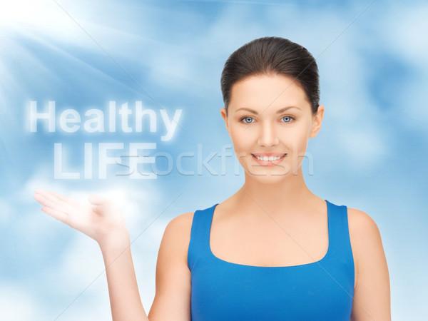 Egészséges élet kép nő tart szavak pálma Stock fotó © dolgachov