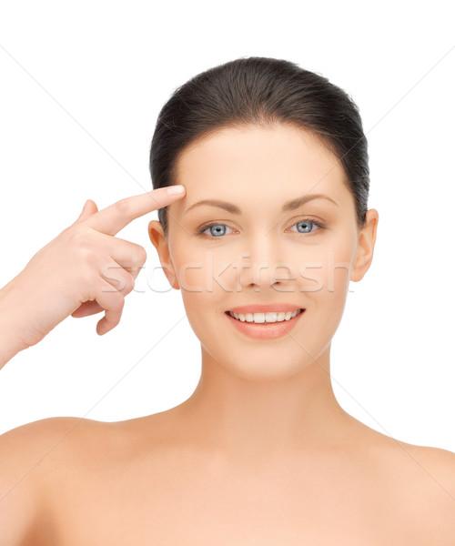 красивая женщина прикасаться лоб лице женщину улыбка Сток-фото © dolgachov