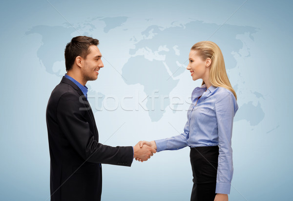 Stock photo: woman and man shaking hands