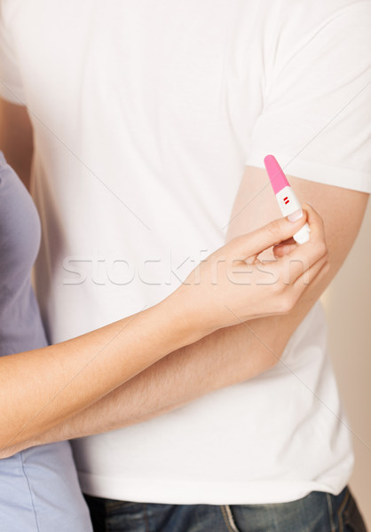 woman and man hands with pregnancy test Stock photo © dolgachov