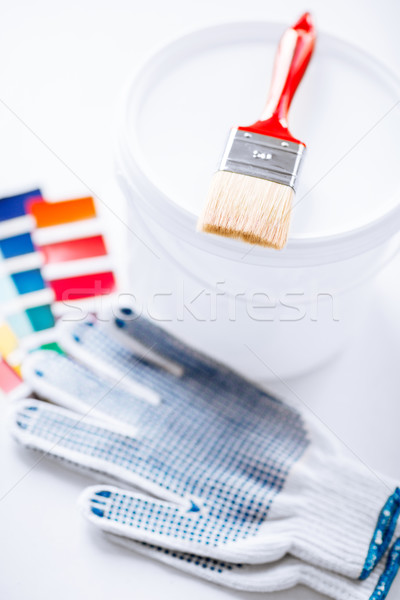 paintbrush, paint pot, gloves and pantone samples Stock photo © dolgachov