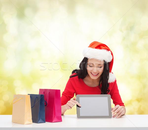 Glimlachende vrouw helper hoed christmas Stockfoto © dolgachov