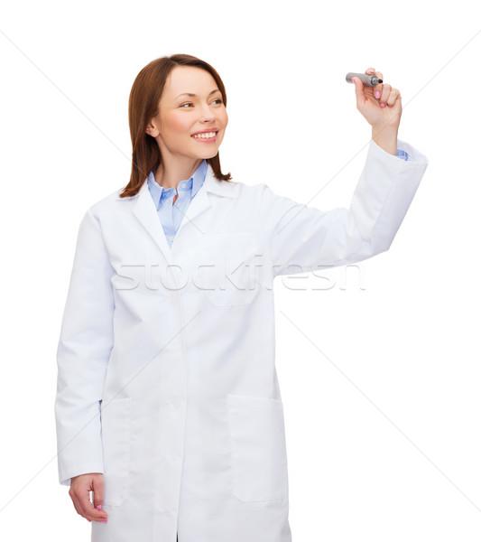 Fiatal női orvos ír valami levegő Stock fotó © dolgachov
