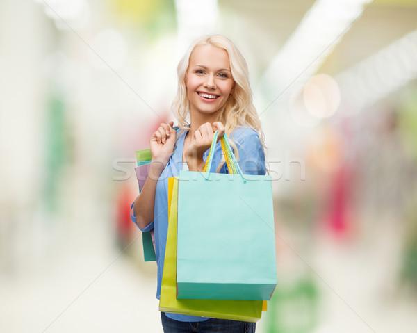 Gülümseyen kadın çok perakende satış para Stok fotoğraf © dolgachov