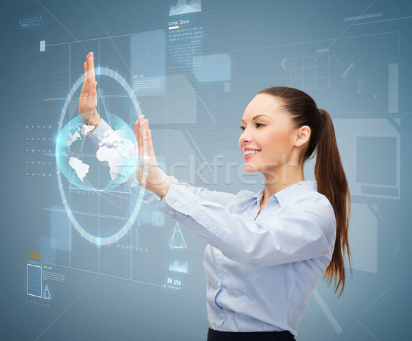 Stock photo: smiling businesswoman working with virtual screen