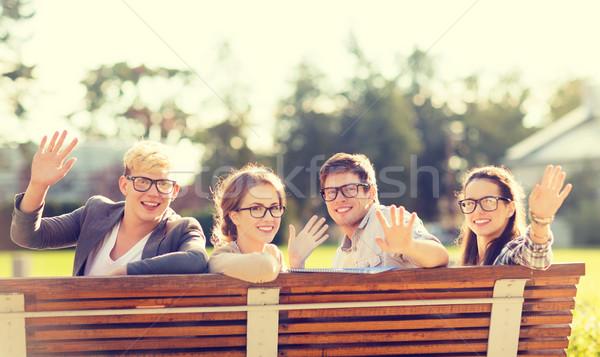 Csoport diákok tinédzserek integet kezek nyár Stock fotó © dolgachov