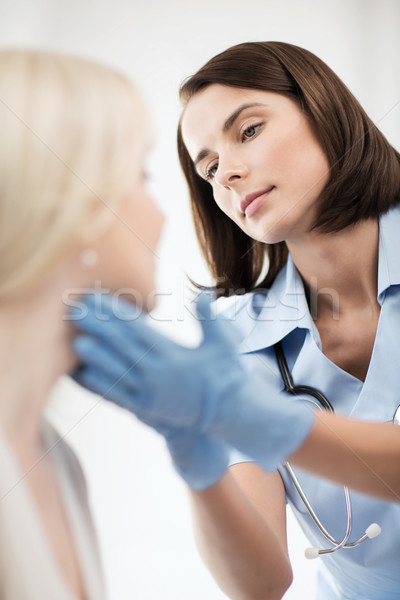 plastic surgeon or doctor with patient Stock photo © dolgachov