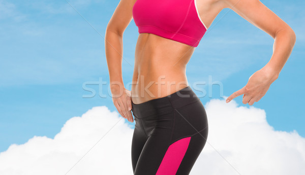 close up of sporty woman pointing at her buttocks Stock photo © dolgachov