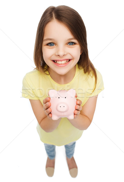 beautiful little girl with piggy bank Stock photo © dolgachov