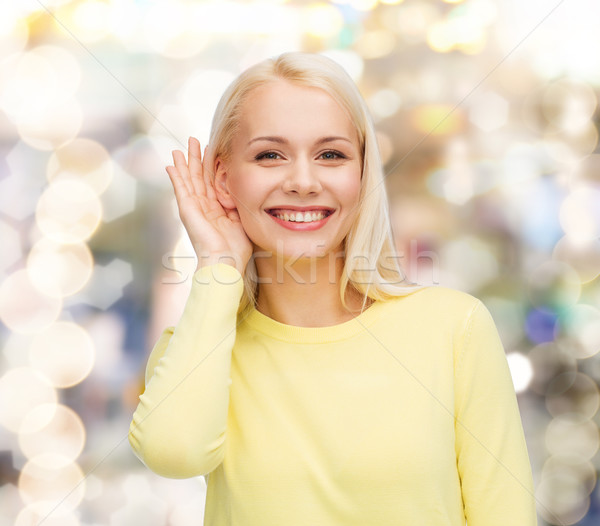 smiling young woman listening to gossip Stock photo © dolgachov