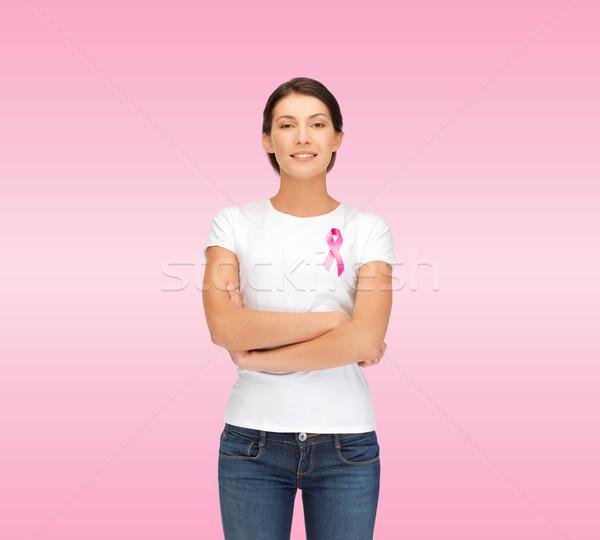smiling woman with pink cancer awareness ribbon Stock photo © dolgachov