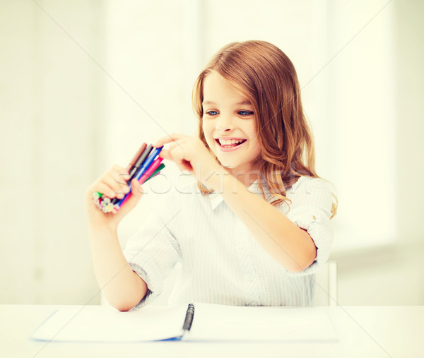 smiling girl choosing colorful felt-tip pen Stock photo © dolgachov