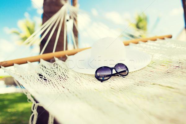 Kép függőágy fehér kalap napszemüveg vakáció Stock fotó © dolgachov