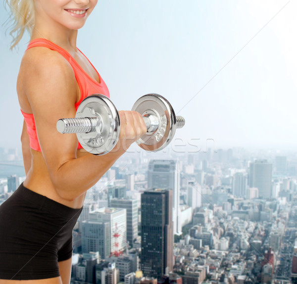 close up of sporty woman with heavy steel dumbbell Stock photo © dolgachov