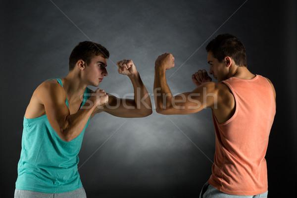 Genç erkekler güreş spor rekabet güç insanlar Stok fotoğraf © dolgachov