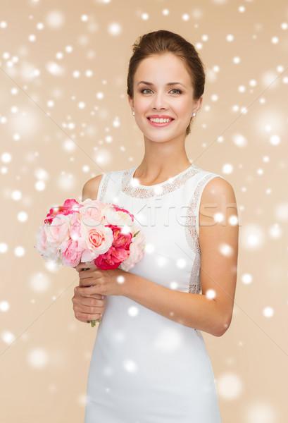 笑顔の女性 白いドレス 花 幸福 結婚式 ストックフォト © dolgachov