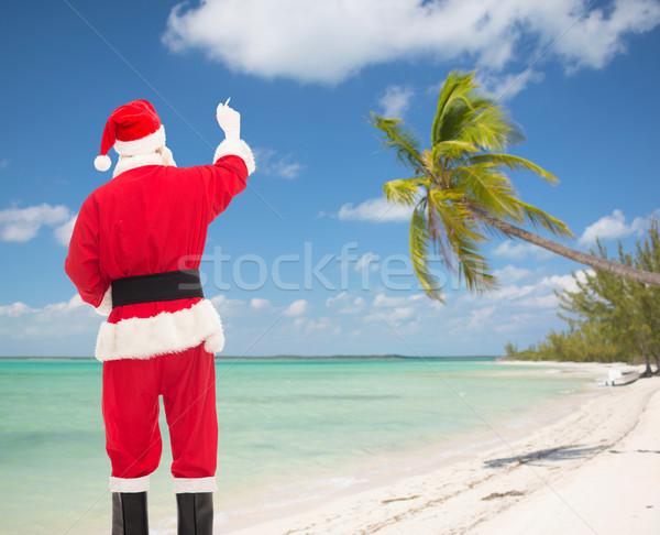 человека костюм Дед Мороз Дать что-то Рождества Сток-фото © dolgachov