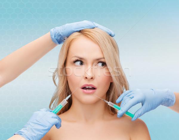 Cara da mulher mãos beleza pessoas cirurgia plástica mulher Foto stock © dolgachov