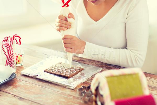 Kobieta piernik domów gotowania Zdjęcia stock © dolgachov