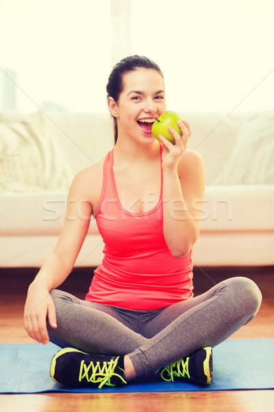 smiling teenage girl with green apple at home Stock photo © dolgachov