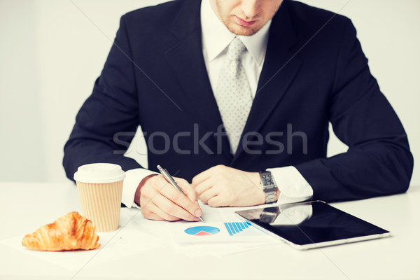 man with tablet pc and cup of coffee Stock photo © dolgachov