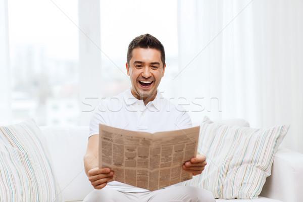 Mutlu adam okuma gazete gülme ev Stok fotoğraf © dolgachov