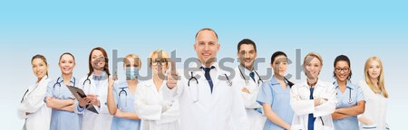 group of medics with stethoscopes Stock photo © dolgachov