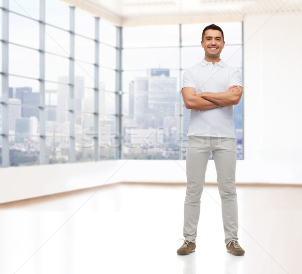 smiling man with crossed arms Stock photo © dolgachov